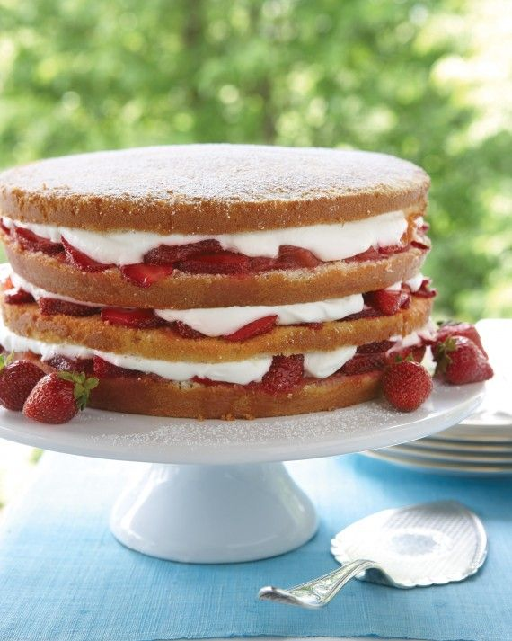 In+this+delectable+cake,+fresh+strawberries+mixed+with+strawberry+or+rhubarb+jam+and+whipped+cream+are+tucked+between+four+layers+of+buttermilk+cake.+Sprinkle+the+top+with+confectioners'+sugar+just+before+serving.