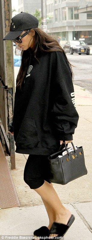 Missing him? Kim Kardashian was spotted keeping cozy in one of Kanye West's sweatshirts in New York City on Saturday, after the rapper had been away performing in Canada