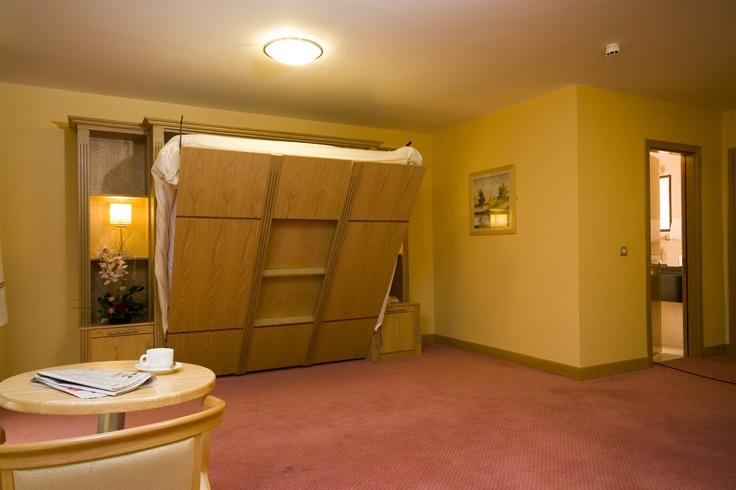Oak wallbed with flutting and storage units works great in this meeting in The Viking hotel!