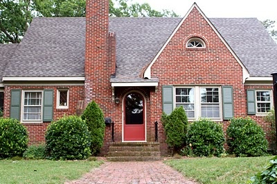 Red Brick House With Shutters And Siding