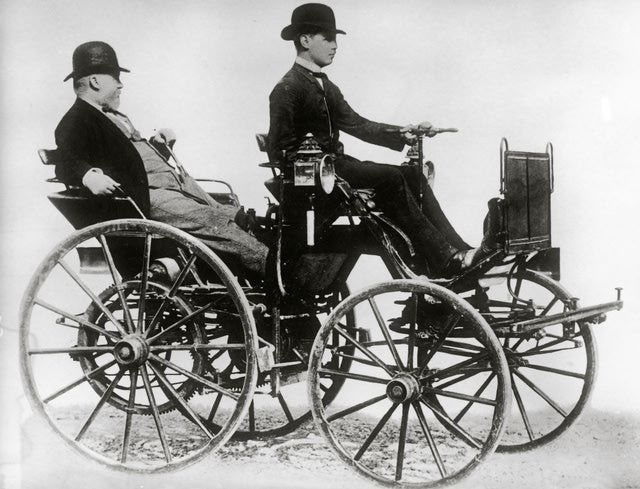 Meet Gottlieb Daimler: Father of the Gas-Powered Car: Gottlieb Daimler sitting in a motor vehicle (constructed by himself). Photography. 1886