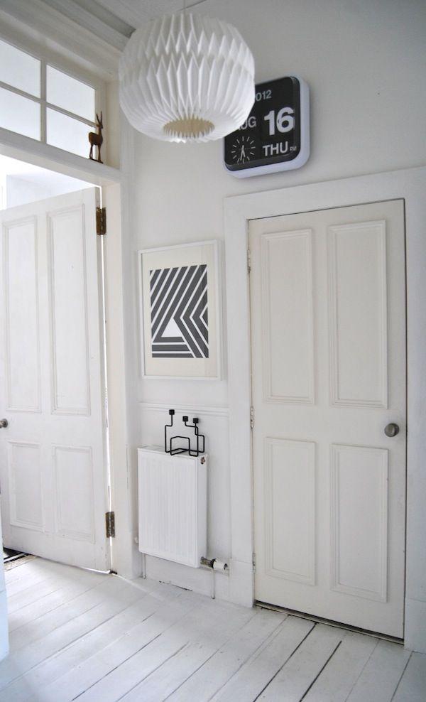 apieceofcake: The Doors, All White, Window, Black And White, Clock, Design Interiors, Black White, White Woods Floors, White Wall