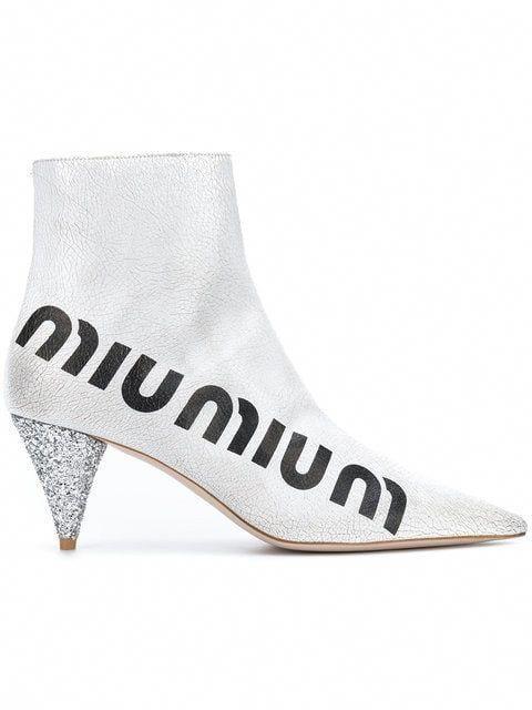 a0306abf50a0 Shop Miu Miu crackled logo boots  MiuMiu