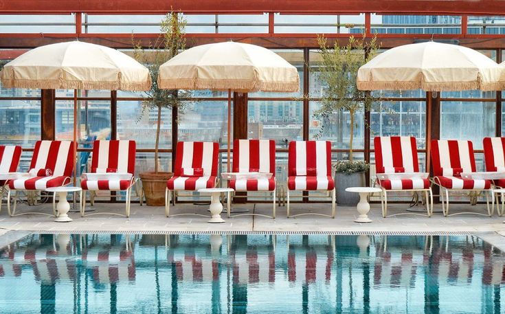 Shoreditch House in London, cool members club pool with striped sunloungers