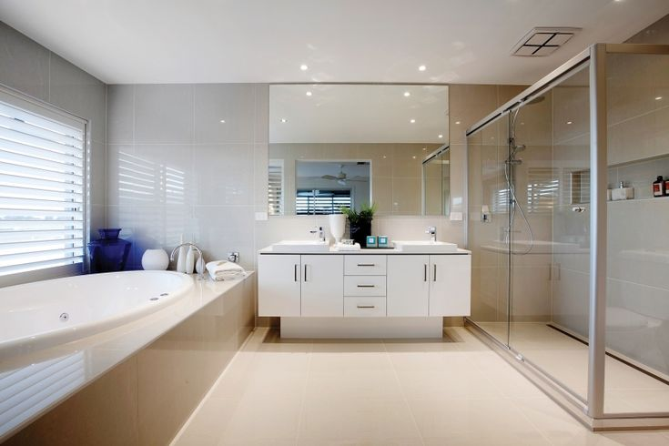 A clean white palette is used to convey the beauty of the Greek islands in this bathroom. Complete luxury is catered for with large spa bath and functional cabinetry provides stylish storage.