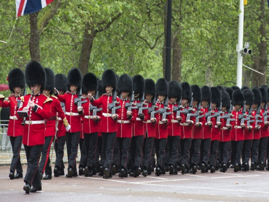 Queen off to the races for Diamond Jubilee.  Soldiers from the Queen's Guard march down the Mall outside Buckinham Palace in London, On June 2, 2012.  Britain began four days of festivities for Queen Elizabeth II's Diamond Jubilee.