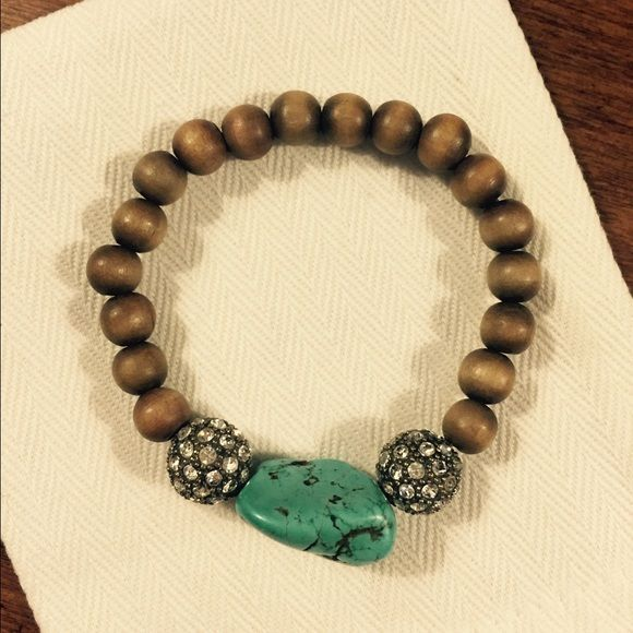 STELLA AND DOT BRACELET Stretch bracelet with wooden beads and a turquoise colored stone.  Fitted to a small wrist. Stella & Dot Jewelry Bracelets