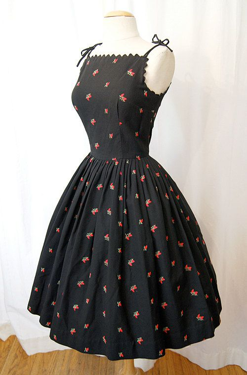 vintage. 1950's black pique cotton sun dress with red rose bud embroidery.