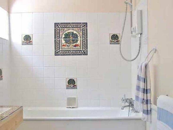 bath wall tile designs with stripped towel httplanewstalkcom - Bathroom Tile Ideas Cheap