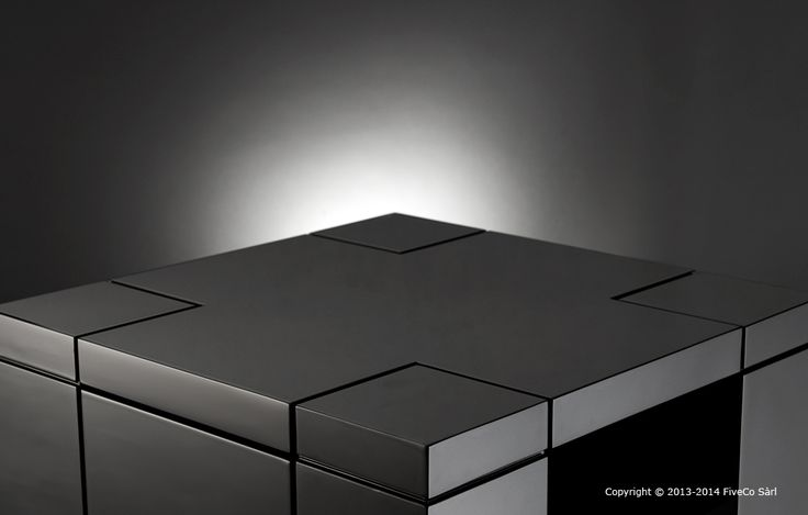 Black laquered Nightstand. This black, high gloss nightstand was designed and developed by Fiveco, in the same line as the nightstand in cherrywood.  Its particularity is the hidden compartment in one of the legs, like a capsule that can only be opened thanks to a digital fingerprint reader.