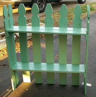 picket fence repurposed into a plant shelf (shelves could be deeper to hold baskets of cards along the back of a table display for height)