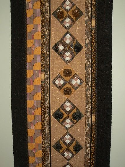 """Cinnamon"" Art quilt work 2006. Different materials and 3D-patchwork tecknics (teach by Lucie Huiz)."