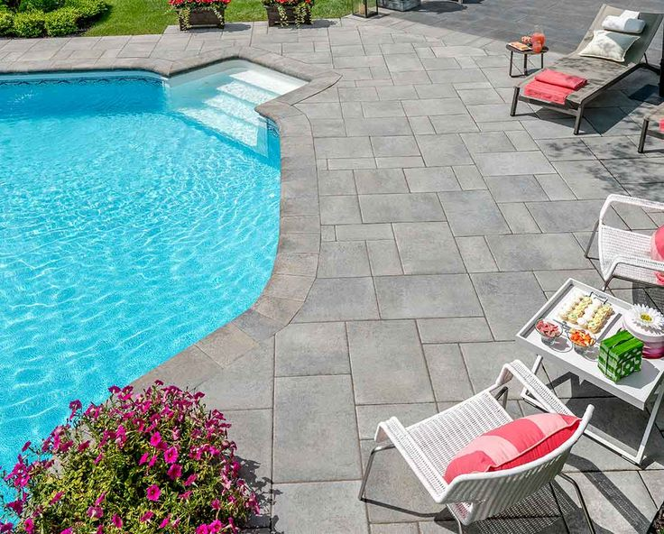 Outdoor backyard party ideas with colorful outdooring and pool slabs by Rinox Inc