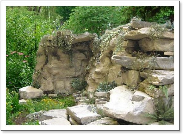 fake rock structure to shelter entrance - Fake Rocks