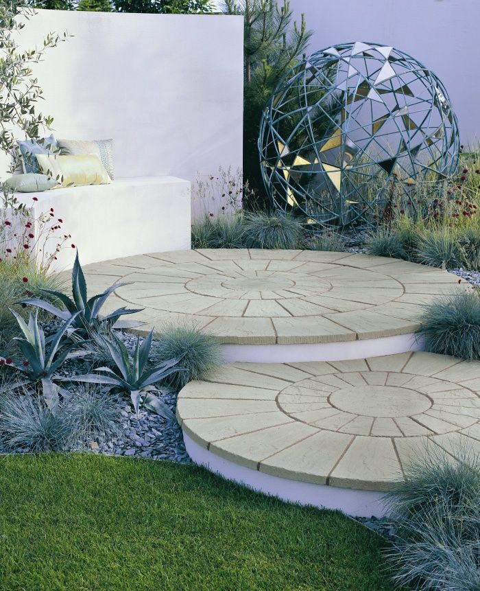 This Contemporary Garden Landscape With Seating Has Been Created Using  Stonemarket Weathered Yorkstone Paving Circles To Create A Stepped Circular  Patio.