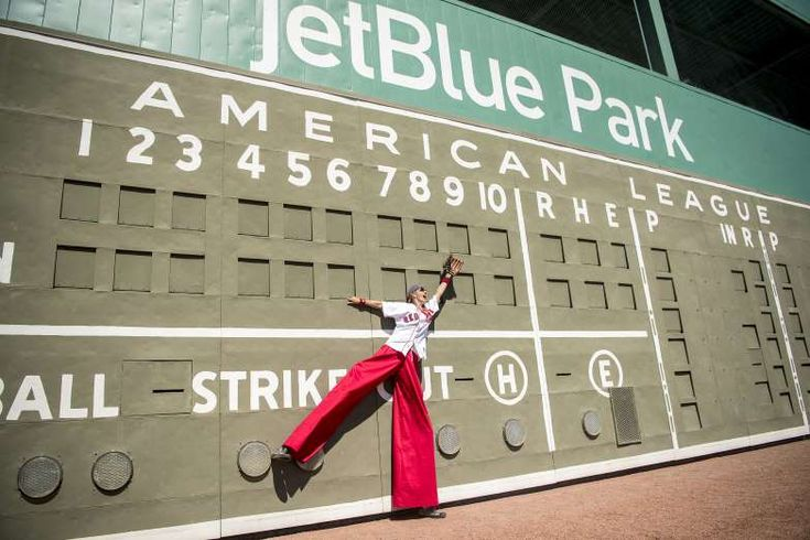 2018 MLB spring training - NICE POSE An entertainer poses in front of the Green Monster scoreboard during a Red Sox open house on Feb. 17 in Fort Myers, Florida.