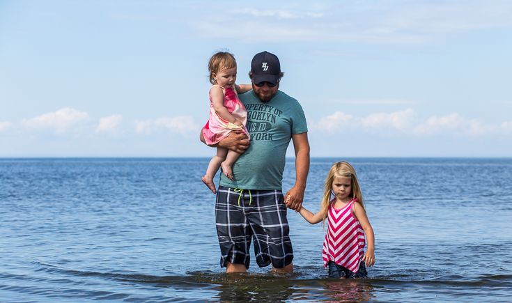 Family Documentary Photography - Beach session - Daddy walking on the beach with two daughters - Bathurst NB Photographer- Tara Geldart Photography