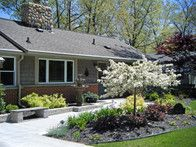 Landscaping for a Michigan Ranch...This Michigan ranch house had a few basic shrubs around the front of the house, and looked rather plain.  Use Malus 'Tina' crabapple as an accent. Adding a very different walk layout and flagstone bench gave the home a clean, contemporary look.