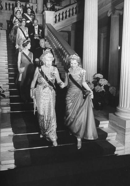 September 18, 1964, wedding day of King Constantine of Greece , son of the late King Paul and Queen Frederika with the princess Anne-Marie of Greece , youngest daughter of King Frederik and Queen Ingrid Gotha are all gathered in Athens for the happy royal event. Here is a photo taken on the grand staircase of the Palais Royal, where Queen Ingrid of Denmark and Queen Victoria Eugenie of Spain descend the last steps. ( Copyright Photo: Life )