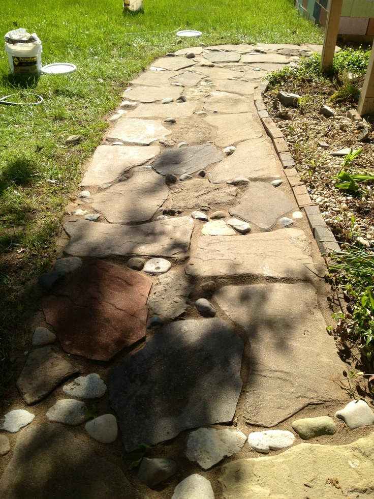 Stone Walk Way With River Rock And Polymer Sand To Fill In