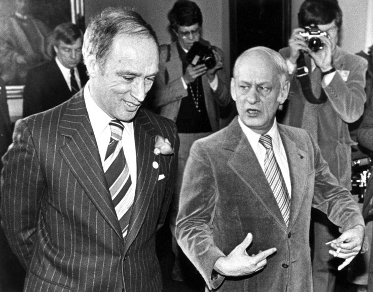Trudeau and Levesque conversing after a session of negotiations.
