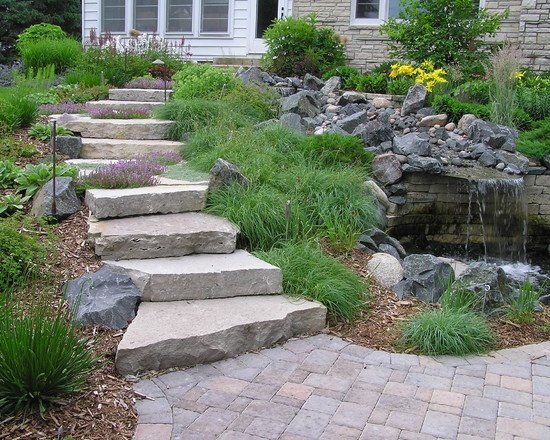1000 images about landscaping ideas with stone on for Stone retaining wall ideas