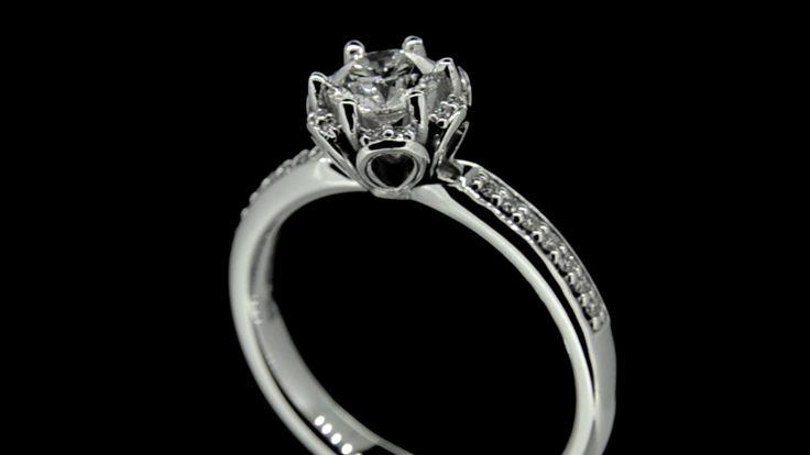 'ADELE' .. Diamond Solitaire set with Brilliant Cut Diamond in Pretty Loop Setting in 18ct White Gold.. Total Dia.Wt. 0.64 carat - G/VS1 Cert.