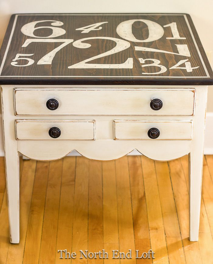 The North End Loft: Graphic End Table - could recreate one similar with a garage sale or flea market find.