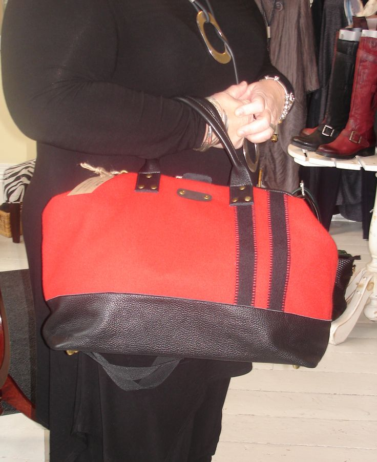 Large red felt & black leathre C.A.P. handbag by Canadian Designer Karen Wilson.  Perfect for the woman who travels large:) Avail in downtown Port Perry at Brittany N Bros just off the main street at the 4way stop. Look for brittanynbros on Facebook & Twitter and sign up for our newsletter at http://www.brittanyandbros.com
