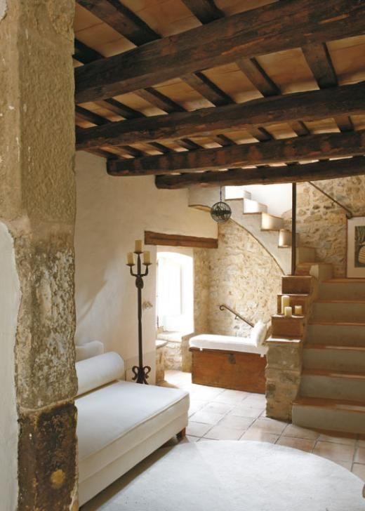 Love this rustic stone entryway with open beams