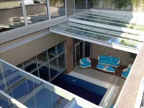 25 best ideas about pool enclosures on pinterest for Indoor pool with retractable roof