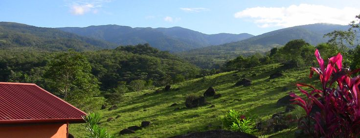 Eastern Talamanca mountain range and La Amistad International Park views with pasture, cabin and garden in the foreground.