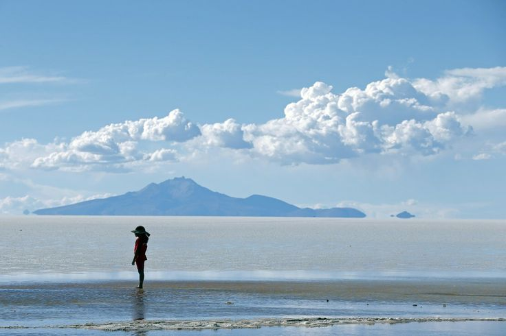 SOLITARY: A child stood on the Salar de Uyuni salt flat in Bolivia before the seventh stage of the 2014 Dakar Rally on Saturday. (Jean-Paul Pelissier/Reuters)
