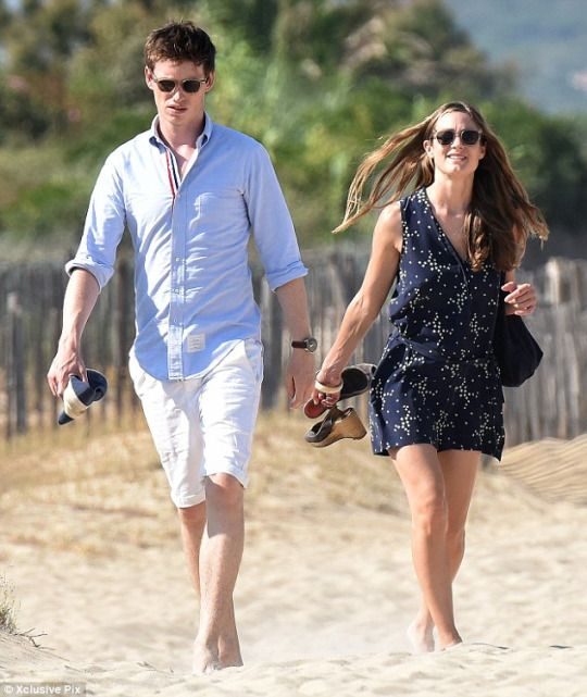 7/12/15 Eddie Redmayne and wife Hannah Bagshawe stroll on the beach in St Tropez… seven months after tying the knot.
