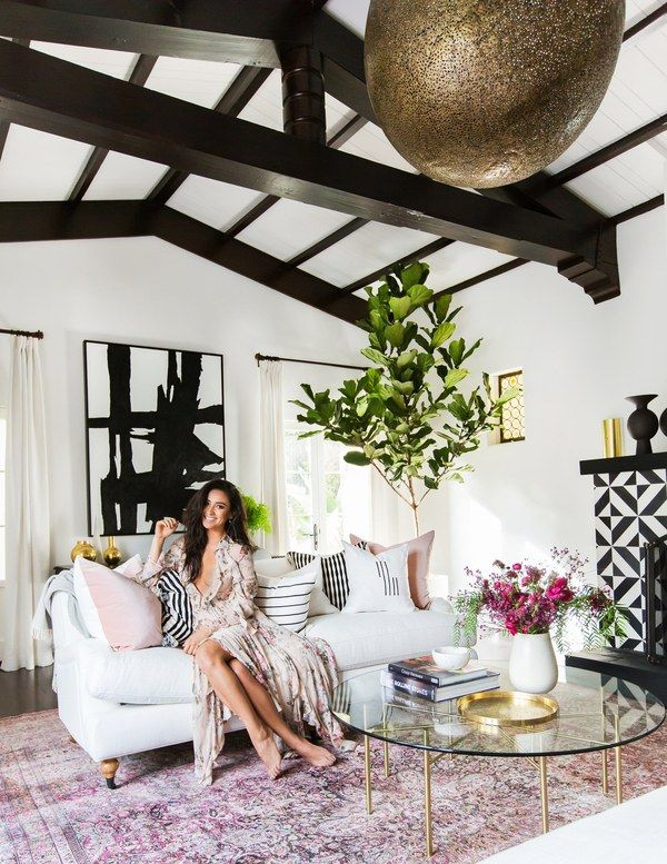 """In her """"favorite room to look at,"""" Shay Mitchell herself is the centerpiece, reclining on a sofa from Interior Define 