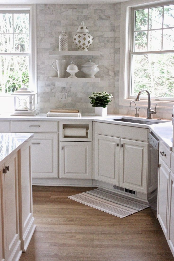 White Quartz countertops and the backsplash is Carrera Marble subway tiles--pic from Forever Cottage,blogspot