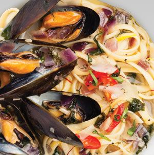 Mussel Linguine with Tomato and Basil needs nothing more than a salad and some crusty bread. You'll want that bread to sop up all those yummy juices from the mussels.