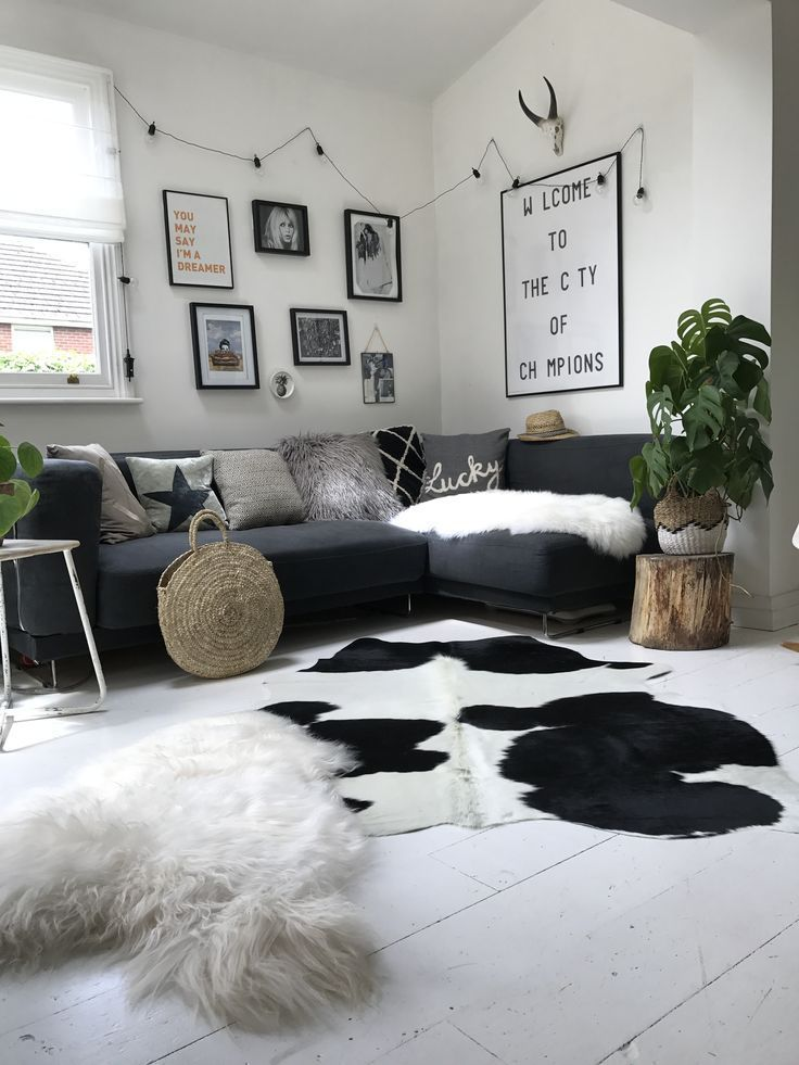 A Classic Black And White Cowhide Rug Displayed In Our Cool Nordic Setting Hide Rug Living Room Cowhide Rug Living Room White Cowhide Rug