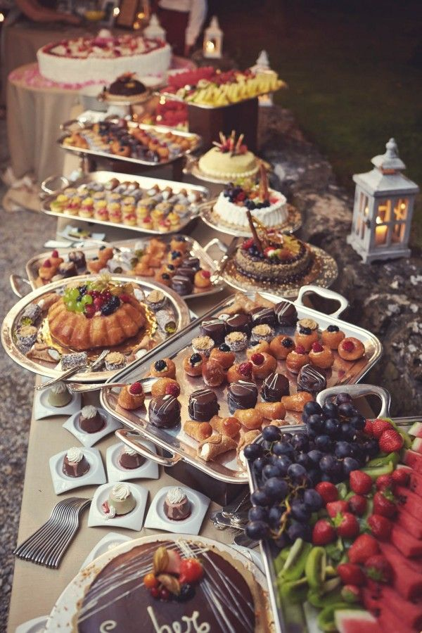 Talk about a dessert table! Yum! Photo by Jules Bower