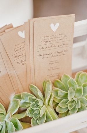Single, bookmark-shaped wedding programs for ceremony with simple decoration at top. (would work for reception menus, too)