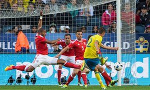 Mikael Lustig scores Sweden's second goal in the friendly against Wales.