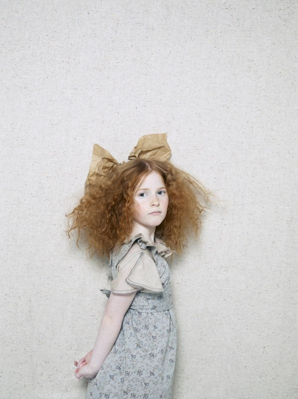 love the high fashion feel, big hair and paper bow and floral dress