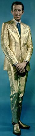 Porter Wagoner (Nudie's gold lamé suit for Elvis is a hard act to follow.)