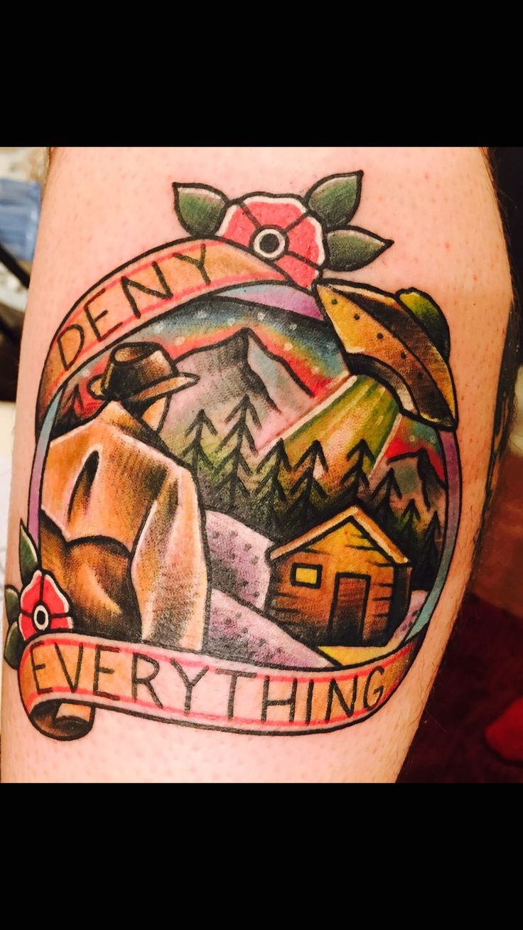Deny Everything. Traditional landscape tattoo with UFO by Brandon Smith at Rend City Tattoo; Benton, IL.