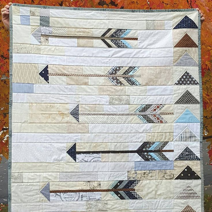 Pieced Arrow.  Requires mostly solid fabrics with a narrow or small arrow design for the binding and any arrow design for the backing.   Complicated.