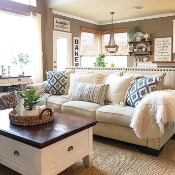 A Beautiful Living Room With Lots Of Soothing Neutrals And Blue Couch Pillows