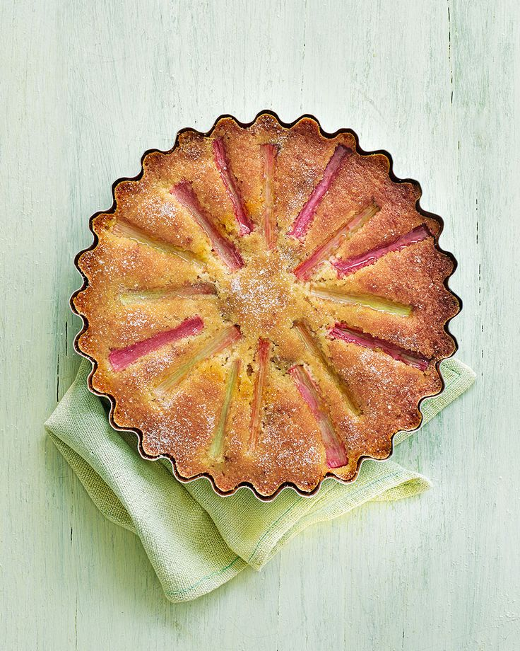 The flavours of rosemary and amaretti come together to make this beautifully light rhubarb cake with a herby orange glaze – serve with something creamy for afternoon tea.