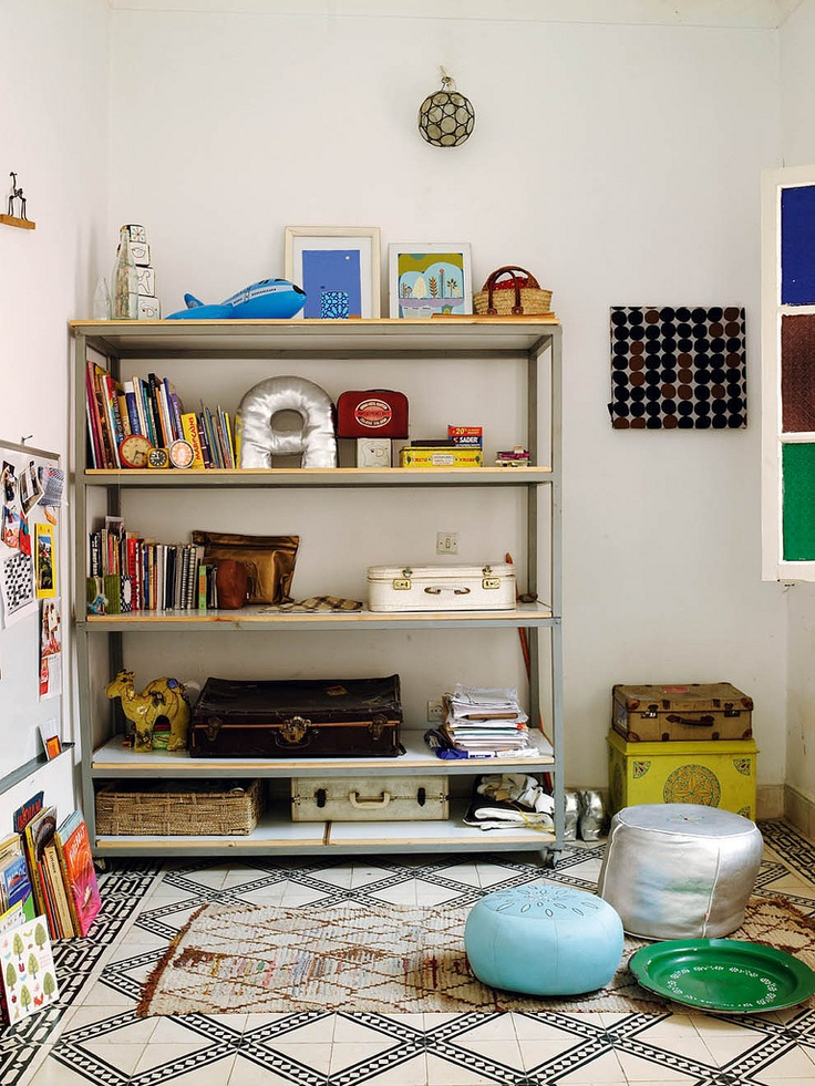 Eclectic kids' rooms love the use of an industrial shelf