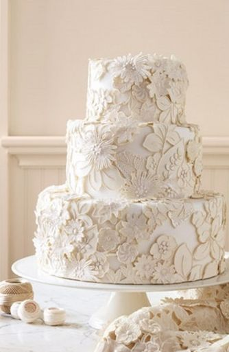 Lace wedding cake!!  Absolutely breathtaking.  You can't tell where the real lace begins and the fondant takes over.  Love how the antique linen wraps itself around the base so that it makes it almost impossible to tell.  Simply stunning!