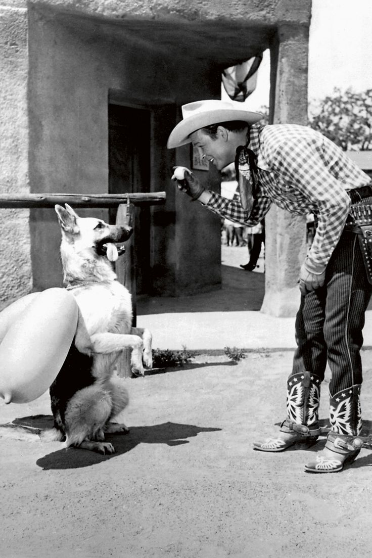Roy Rogers, Republic Pictures, 1951:  The German Shepherd Bullet and his owner Roy Rogers on the set of The Roy Rogers Show. Bullet was never quite as famous as Roy Rogers' horse Trigger, but was an integral part of the many films, television shows, books and comics that were produced.